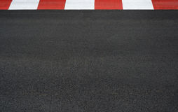 Texture of motor race asphalt and curb Grand Prix circuit. Texture of motor race asphalt and red white curb on Grand Prix street circuit Royalty Free Stock Photos