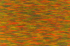 Texture of mottled fabric with orange and green touches Royalty Free Stock Image