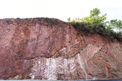 Texture of mountain showing red soil after excavated Royalty Free Stock Images