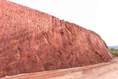 Texture of mountain showing red soil after excavated Royalty Free Stock Photo