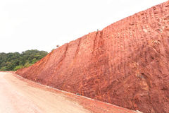 Texture of mountain showing red soil after excavated Stock Photo