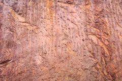 Texture of mountain showing red soil and rock Stock Photos