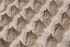 Texture of mountains in the close-up picture of cardboard tray for eggs. Royalty Free Stock Image