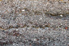 Texture from a multicolored stone and slag. Royalty Free Stock Image