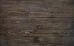 texture of natural dark wood, wooden brown flat boards Stock Photos