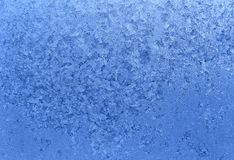 Natural ice pattern on winter glass Stock Photos