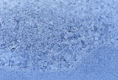 Natural ice pattern on winter glass Stock Images