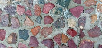 The texture of natural stone and granite. Close-up. Cobblestone pavement. stock images