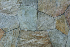 Texture of natural stone granite pieces tiles for walls Royalty Free Stock Photography