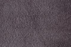 Gray suede. Texture of natural suede. Soft, raised pile. Solid color. High-quality leather dressing Royalty Free Stock Photography