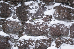 Texture, natural winter background. Winter stone masonry wall building Royalty Free Stock Photography