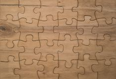 Texture natural wooden puzzles collected. Concept of business ideas, advertising design Royalty Free Stock Image