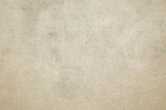 Texture with a neutral color. The texture of the concrete walls painted beige Stock Photos