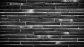 Texture noire de mur de briques, surface de brique pour le fond Papier peint de cru photo libre de droits