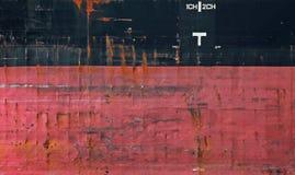 Texture noire et rouge de coque de cargo photos stock
