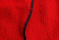 Texture noire rouge de tissu de laine des vêtements Image stock