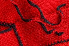 Texture noire rouge de tissu de laine des vêtements Photos stock