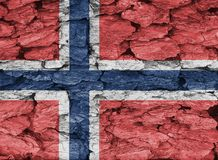 Texture of Norway flag. The texture of Norway flag on a decorative dry tree bark royalty free stock images