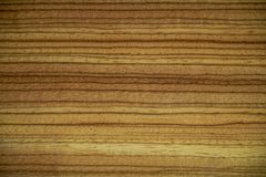 Texture of nut wood on a piece of furniture stock image