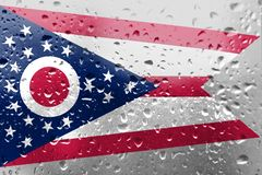 Texture of Ohio flag on the glass with drops stock photos