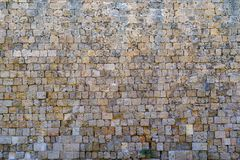 Texture of an old and ancient stone wall Stock Photo