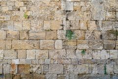 Texture of an old and ancient stone wall closeup Stock Photo