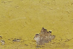 Texture of old antique vintage crackled yellow wall. Closeup. Stock Images