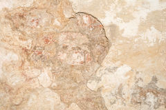 Texture of the old antique wall of yellow-sand color, there are fractures of the white protective layer of plaster from the effect Stock Images
