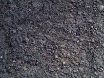 Texture of old asphalt with stones Stock Images
