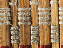 Texture of old bamboo branches with threads. Stock Photos