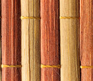Texture of old bamboo branches with threads. Royalty Free Stock Image