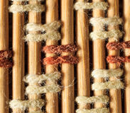 Texture of old bamboo branches with threads. Royalty Free Stock Photo