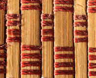 Texture of old bamboo branches with threads. Stock Images