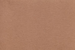 Texture of old beige paper closeup. Structure of a dense cardboard brown color. The background. Stock Images