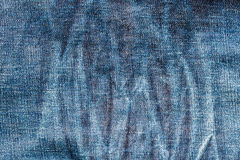 Texture of old blue jeans textile close up with fade. From long time used Royalty Free Stock Image