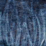 Texture of old blue jeans textile close up with fade Stock Images