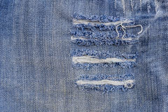 Texture of old blue jeans at torn Royalty Free Stock Photography
