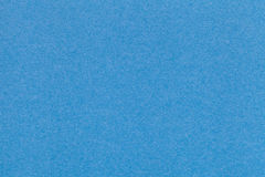 Texture of old blue paper closeup. Structure of a dense cardboard. The azure background. Royalty Free Stock Image