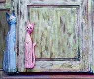 Texture of old boards with wooden cats Royalty Free Stock Photo