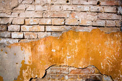 Texture of old brick and dingy yellow Stock Photo