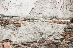 Texture of old brick wall with cracked plaster Stock Photos