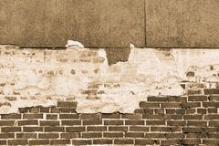 Texture of an old brick wall with destroyed plaster Royalty Free Stock Photography
