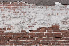 Texture of an old brick wall with destroyed plaster Stock Photo