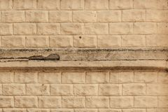 The facade of the old house. Texture. Brick wall royalty free stock image