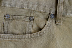 Texture of Old Brown Denim Jeans Part of Trousers. Royalty Free Stock Photo