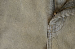 Texture of Old Brown Denim Jeans Part of Trousers. Stock Images