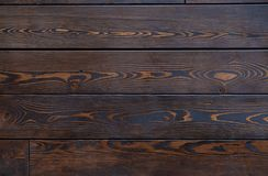 Texture of old brown floor boards with fibers. Background image royalty free stock photography