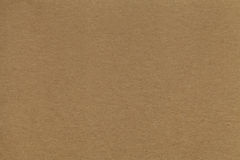 Texture of old brown paper closeup. Structure of a dense cardboard. The background. Stock Image