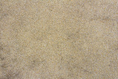 A texture of old brown small stones on concrete floor at swimming pool side. Royalty Free Stock Images