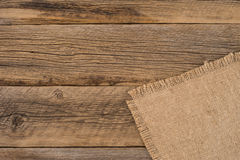 Texture of the old burlap and wood. Royalty Free Stock Image